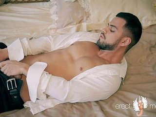 Sexy bearded and suited man masturbation on the bed