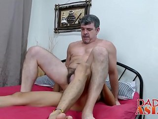 Big cock mature Daddy has fun with his Asian bitch Andrew
