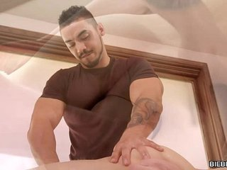 Gay man gives massage and blowjob to a twink